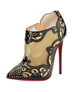 """Christian Louboutin Mandolina Laser-cut Mesh Bootie, Black/Gold . . . Christian Louboutin bootie blends romance and rock in laser-cut patent leather with metallic mesh inset and stiletto heel. . . . •Christian Louboutin laser-cut patent bootie with specchio backing. •4 1/2"""" covered stiletto heel. •Metallic mesh vamp. •Back zip. •Pointed toe. •Leather lining and padded insole. •Signature red leather sole. •""""Mandolina"""" is made in Italy. . . . $1,495"""