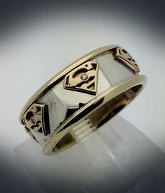 White Gold and Yellow Gold Superman Band by PaulMichaelDesign
