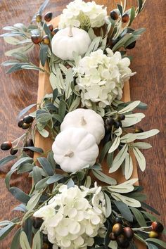 Simple neutral fall DIY centerpiece using a vintage rustic dough bowl, hydrangeas, olive branches and milk paint pumpkins. Perfect farmhouse floral arrangement for Thanksgiving. Great ideas for autumn.