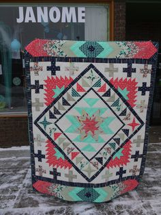 Jackson Hole Quilt. Pattern by Emily Herrick. I don't like the Colors, and I don't like making triangles, but the French Braids at the top and bottom have some potential.