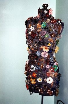 An interesting way to display your vintage brooch collection, on a dress form!