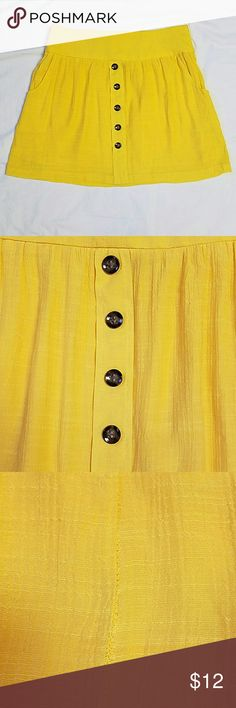 "Charllotte Russe Yellow Skirt M Button front details (bottom one needs to be stitched on better has broken stitches). Fully lined. Rear center seam is a little loose and is an easy repair.  Has belt loops. Sz M Measures 30"" waist,  40"" hips,  16"" overall length.  Minimal wear with no rips or stains.  Only has the two above fixes that need done. Price will reflect the repairs needed. Yellow is a bit darker than camera is capturing. (posh7) Charlotte Russe Skirts Mini"