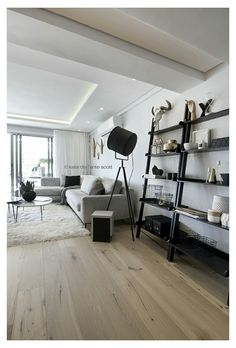 FourOnC Cape Town. Interiors by Del Fante Design Styled black leaning shelves and giant industrial 'search light' lamp. Pallette oak, marble and grey with black accents