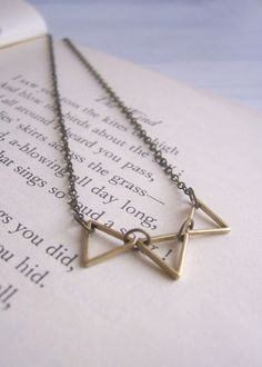 These delicate triangles hang on fine chain. A beautifully simple and sweet necklace.  Total necklace length is 18: the chain is brass trace chain and the triangles are golden brass.  I love to use interesting, vintage and precious items for each piece and all new findings. Each piece comes beautifully wrapped. All items are limited in number and are lovingly handmade in Manchester, England.  Join me on facebook! www.facebook.com/magpiesdaughter