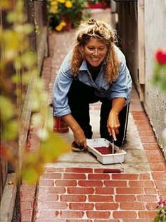 Claudia Darr mixed a batch of brick-red paint and rolled it right onto a concrete walk. After painting a 100-foot-long path in an afternoon, she was so pleased with the results that she went on to faux brick her entire driveway.