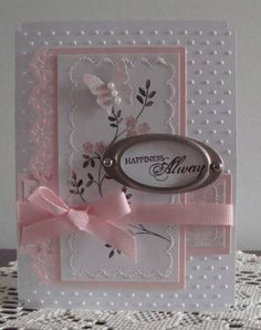 Stamps: Thoughts and Prayers, Happy Harmony  Accessories: pearls, MS Butterfly, EK Success Border Punch, pink grossgrain, hodgepodge hardware, Swiss dots folder, SU scalloped border punch for corners  Paper: Scraps of white, SU Bella Birds, and Pink Pirouette - machine stitching scallop