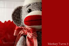 This great sock monkey party inspires me. I want an entire room in my house dedicated to these colors - red and brown/grey/beige? Love it.