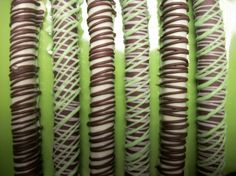 """Celebrate St. Patricks Day""""Irish Cream Infused Green Chocolate covered Pretzels""""      PRETZEL RODS INDIVIDUALLY WRAPPED AND MADE FESH UPON ORDERING !!    Perfect for that BAR that wants to offer a little something special to their customers!!! School PTA meetings! Classroom parties, celebrations with family and more !!    Thank you for visiting The Brittle Box Candy Co. we offer candies in bulk, we are the premiere Brittle Candy Company online ! offering sour candy, Jelly Beans in BULK, you…"""