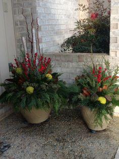 Winter container garden, white birch, magnolia leaves, winterberry, osage oranges, evergreen, lotus pods