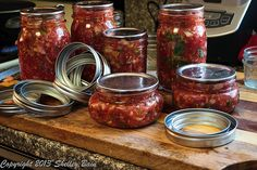 Once you have the hot lids on the jars you will need to put the rings on - the jars and the lids are going to be hot, so be careful Making Salsa, How To Make Salsa, Mason Jars, Rings, Hot, Ring, Mason Jar, Jewelry Rings, Jars