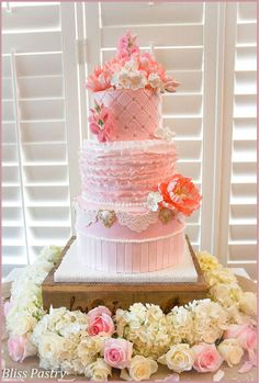 Blush pink wedding cake with ruffles, peonies, sweet peas, and hydrangea
