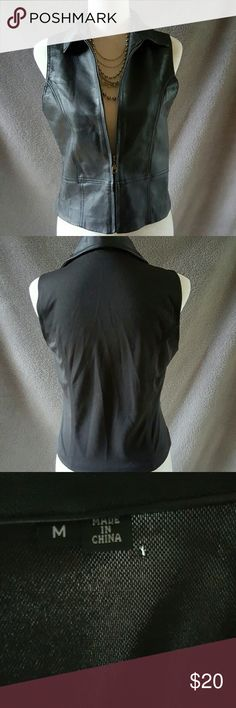 Leather vest Woman's leather vest - leather in front with inside pocket - with liner backside made with a spandex material. Slight hole on back by tag not visible when wearing - see picture - Jackets & Coats Vests