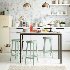 Crafted of solid wood with a simple, streamlined silhouette, our versatile Cafe Bar + Counter Stools offer great style at a great price.