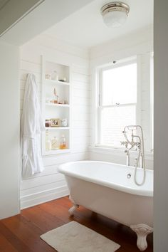 clean + simple + white bathroom with tub and built in shelves