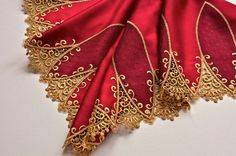 This deep Regal red and gold trim is made of a nice medium weight satin fabric with finely embroidered gold details along its edge. It is a two