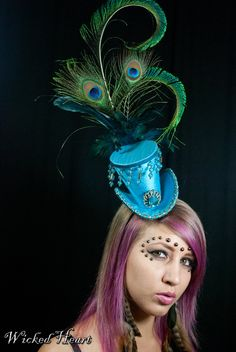 Turquoise Blue Mini Top Hat with Beaded Trim & Peacock Feathers. $79.00, via Etsy.