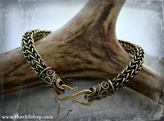 Flexible, bronze Viking style bracelet with filigree ravens terminals and a clasp [sn], €83,00