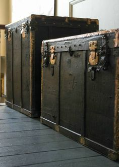 2 large  black trunks with brass edging, both compartmentalised with original lining, circa 1850   Alex MacArthur
