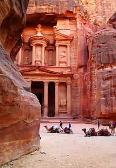 Petra, Jordan - the buildings and the culture are so old.....the hues of the buildings in that light are beautiful.