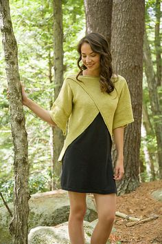 A sweater with cutaway crossover fronts and shirttail back hem.