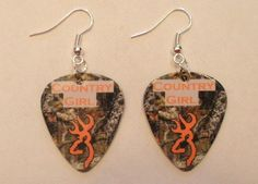 Country Girl Mossy Oak Camo with orange browning deer symbol guitar pick earrings. $6.00, via Etsy.