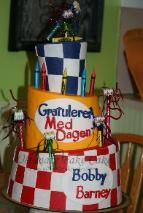 3 tier Topsy Turvy cake with blue and red checkers