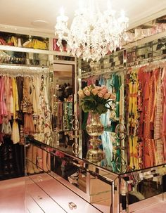 Walk in wardrobe with chandelier