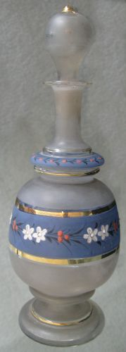 "Item AG7: Antique Victorian Cologne Bottle. Frosted Blue and White with Gold Trim. Hand Painted with White and Red flowers. It stands 9 1/2 ""tall."