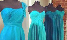 A blue ombre of bridesmaid dresses