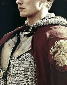 This is classic- the mail, the red cloak, the embroidered patch. This is Erik's aesthetic.