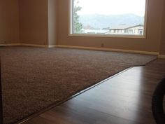 Carpet installed against a Kronotex laminate entry walk. #ogdens #flooring