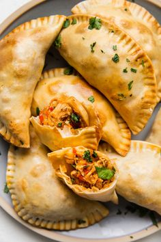 Tender, juicy shredded chicken, onions, peppers and garlic make a hearty, savory filling for our easy chicken empanada recipe. Chicken Empanada Recipe, Spanish Chicken Empanadas Recipe, Empanadas Filling Recipe, Easy Empanada Recipe, Fried Empanadas Recipe, Mexican Empanadas, Empanada Dough, Recipe Chicken, Mexican Dishes