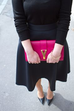 black dress and pink ysl clutch