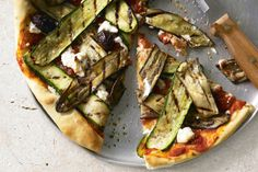 Eggplant and zucchini are perfectly paired on this pizza which won't just be the choice of vegetarians.