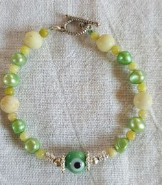 "evil eye peridot ""jasper"" and pearls handmade bracelet sizing available #Handmade #Beaded"