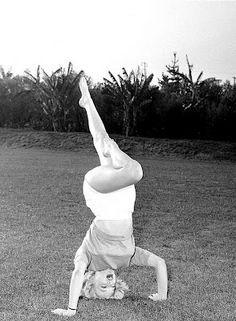 Marilyn Monroe  practices Headstand.
