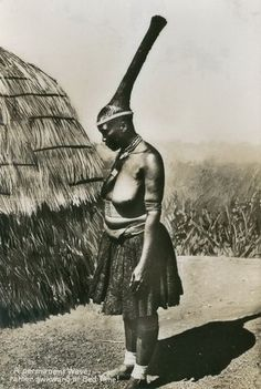 Africa | Zulu woman with her traditional hairstyle.  ca. 1920 || Scanned vintage postcard.