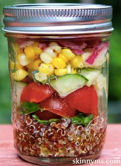 This Mediterranean Quinoa Salad is phenomenal! I like to pack it in jars like this to take it to go. #quinoa #jar #salad #recipe