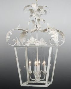The Federalist Designs -Metal and glass with leaves design four light lantern. Shown in standard antiqued white finish.