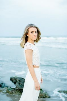 We love this all-white separates look: http://www.stylemepretty.com/north-carolina-weddings/2015/05/22/a-coastal-north-carolina-engagement-session-at-fort-fisher/ | Photography: Melissa DeLorme - http://www.melissadelormephotography.com/