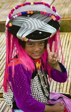 Lisu hilltribe girl in traditional costume . Thailand