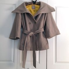 Old Navy 3/4 Sleeve Tie Waist Peacoat Old Navy 3/4 Sleeve Pea Coat, with button closure and flattering tie waist. Oversized collar and beautiful gold lining add a fun/unique flare to a traditional style. The coat has two front pockets, and falls at the hip! Old Navy Jackets & Coats Pea Coats