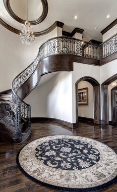 Love this. The iron railing, the wood trim, the floors! The arched doorways. I love love love the hardwood trim and mouldings! -MB