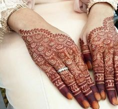 Bridal hand mehendi or henna designs. Engagement ring.