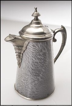 Gray granite ware coffeepot with pewter trim and hinged lid, made in St. Louis by Manning, Bowman and Company ca. 1880-90 | collections.mohistory.org