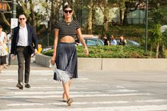 The NYFW Street Style Looks That Truly Stunned #refinery29  http://www.refinery29.com/2014/09/73987/new-york-fashion-week-2014-street-style-photos#slide-177  Giovanna Battaglia's most exclusive accessory? Those abs. Marco de Vincenzo skirt; Reformation shirt; Sara Battaglia  clutch; Rochas flats. ...