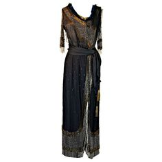 Edwardian Beaded Silk & Net Gown, tissue silk and silk netting with extensive beadwork and metallic tassels