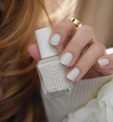 On the nails @essiepolish Marshmallow (3 thin coats) topped it with Essie Matt About You ( for the effect on the tumbler) added the french thin tip, freehand with Essie Good As Gold