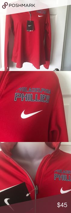 NWT Philadelphia Phillies Nike Dri Fit 1/2 zip Beautiful!  Long sleeve with thumb hole, 1/2 zip with reflective piping, stand up collar. Super soft, 89% polyester/11% spandex. Nike Tops