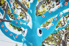 A Yarn Bombed Tree Squid http://www.thisiscolossal.com/2013/10/a-yarn-bombed-tree-squid/